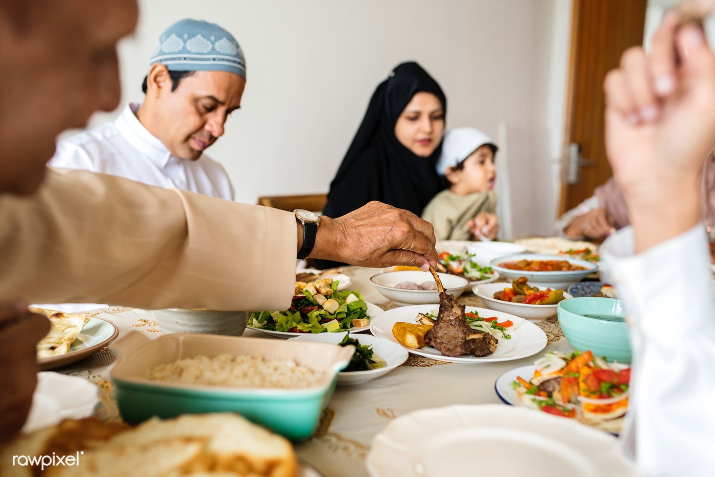 Happy Muslim family eating at home | Royalty free photo - 425879