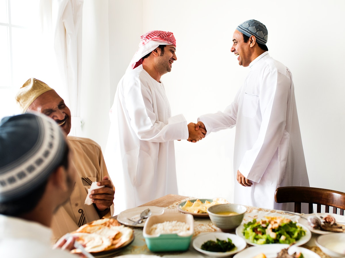 Muslim men shaking hands at lunchtime