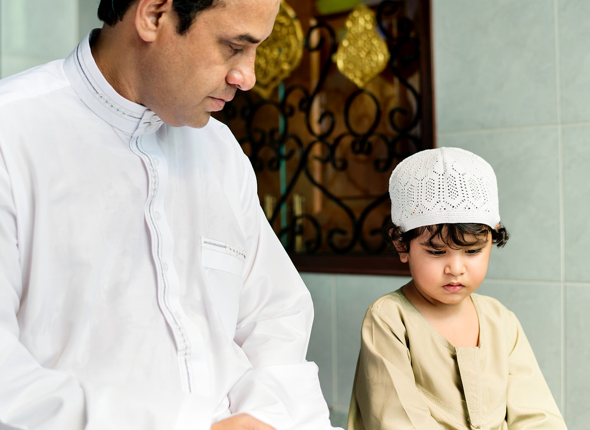 Muslim boy learning how to Salah