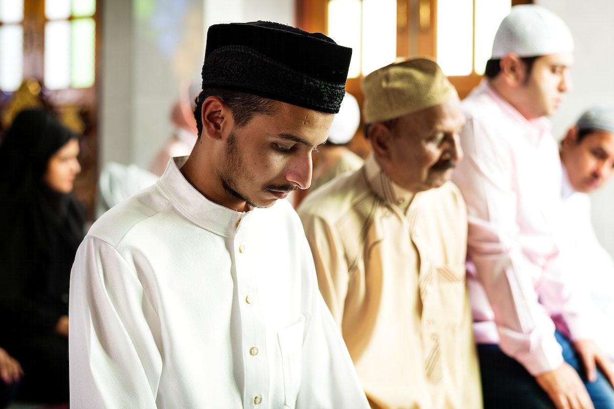 Muslim prayers in Tashahhud posture