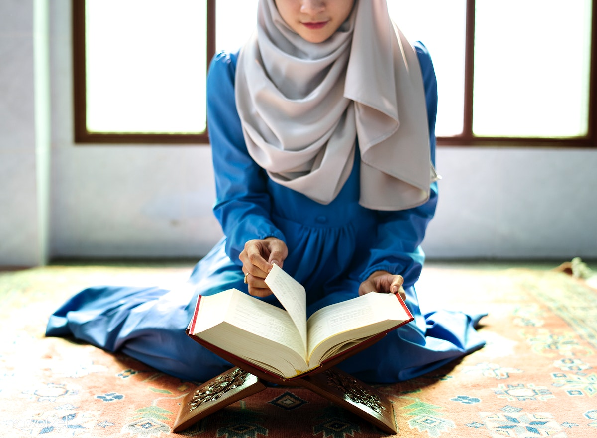 Download premium image of Muslim woman reading from the quran 425958