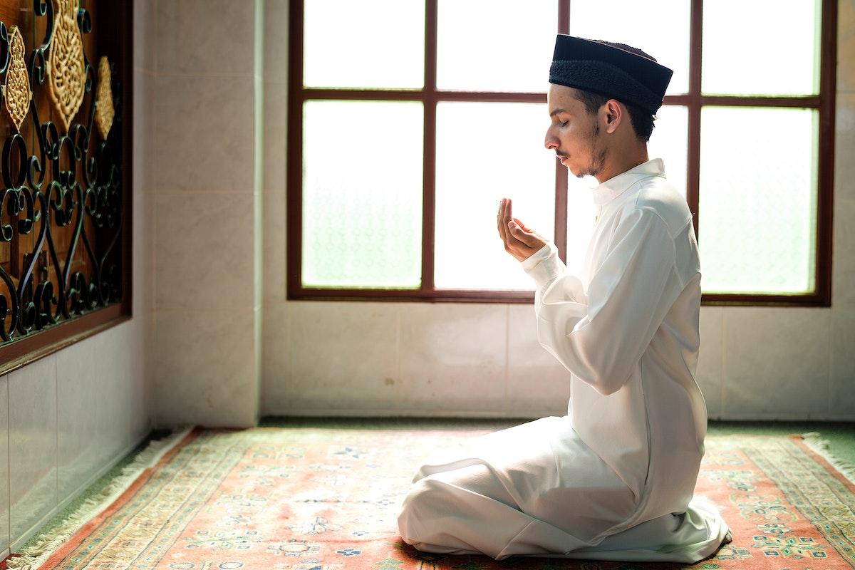 Muslim man making Dua to Allah