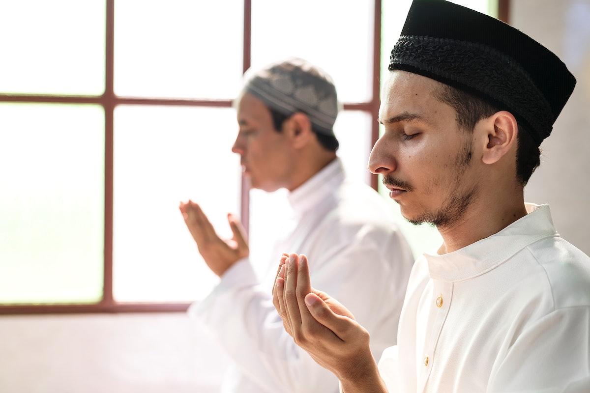 Muslim men making Dua to Allah
