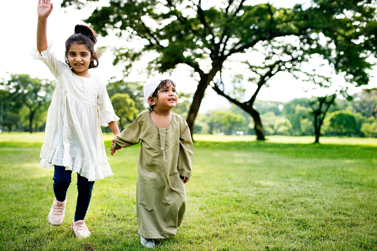 Muslim brother and sister playing in the park