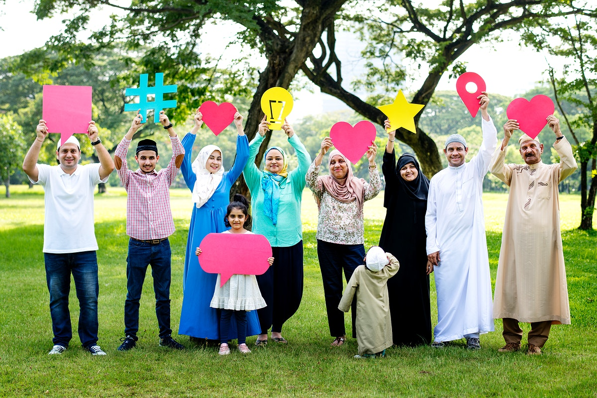 Muslim family holding up various social media icons