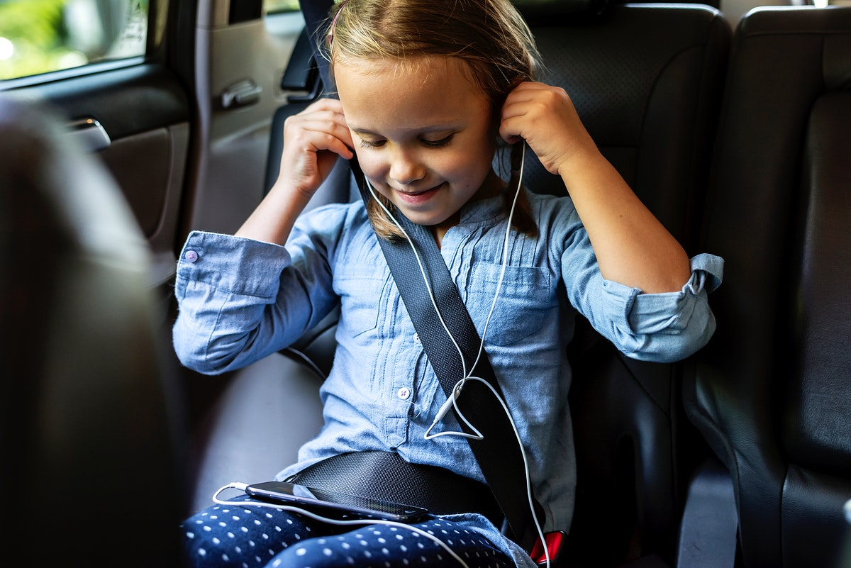 Girl listening to music in the car