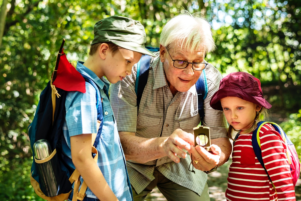Grandfather teaching how to use a compass