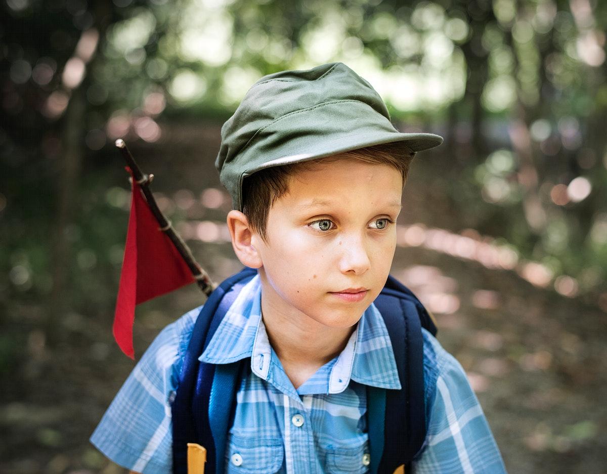 Boy hiking through a forest