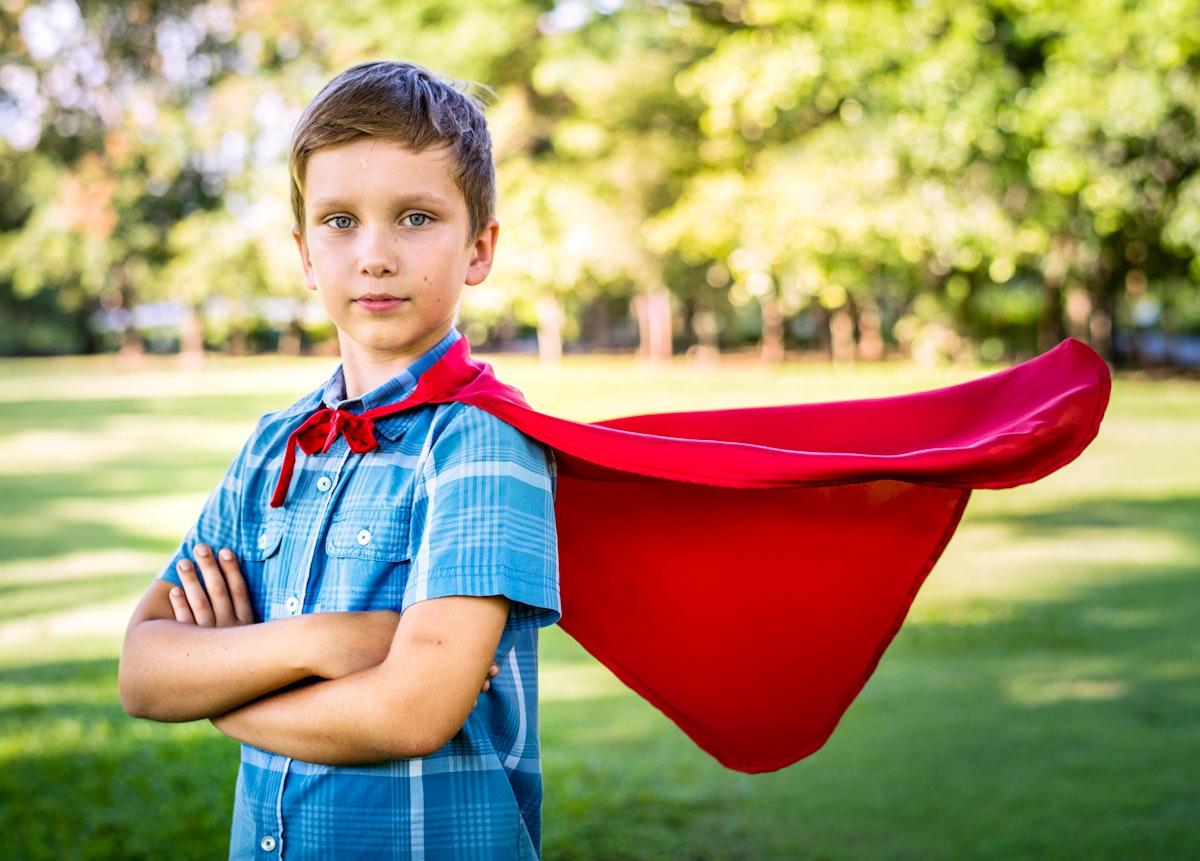 Superhero boy in the park