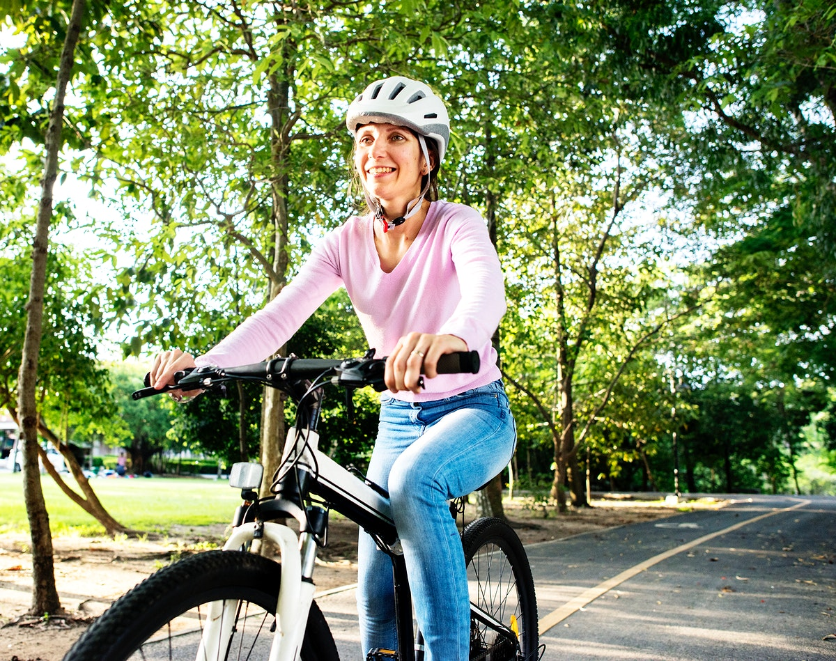 Woman enjoying a bicycle ride in the park