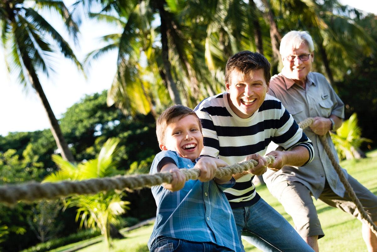 Family playing tug of war
