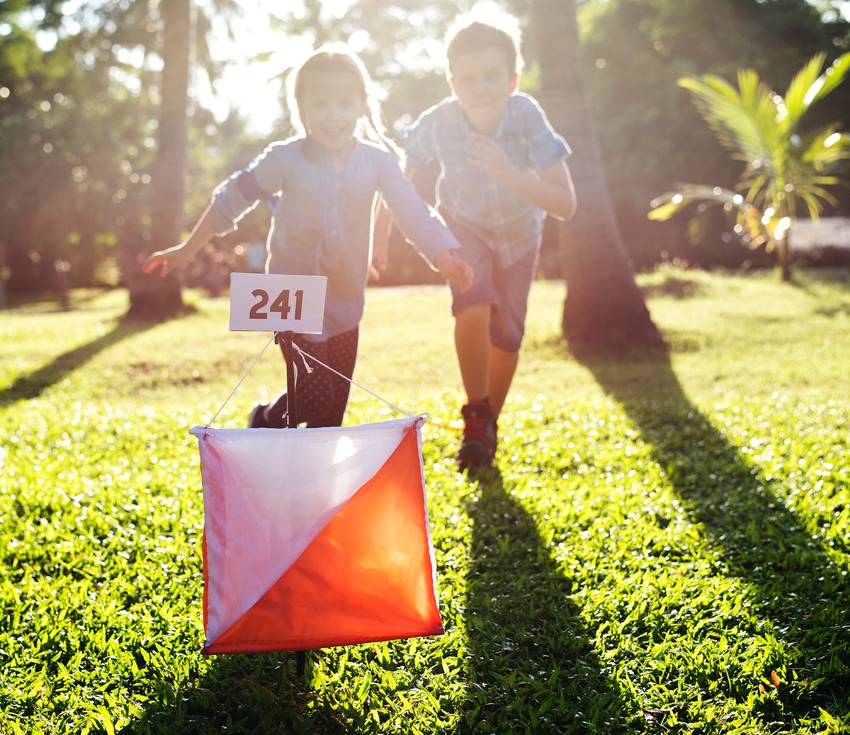 Kids running to a checkpoint