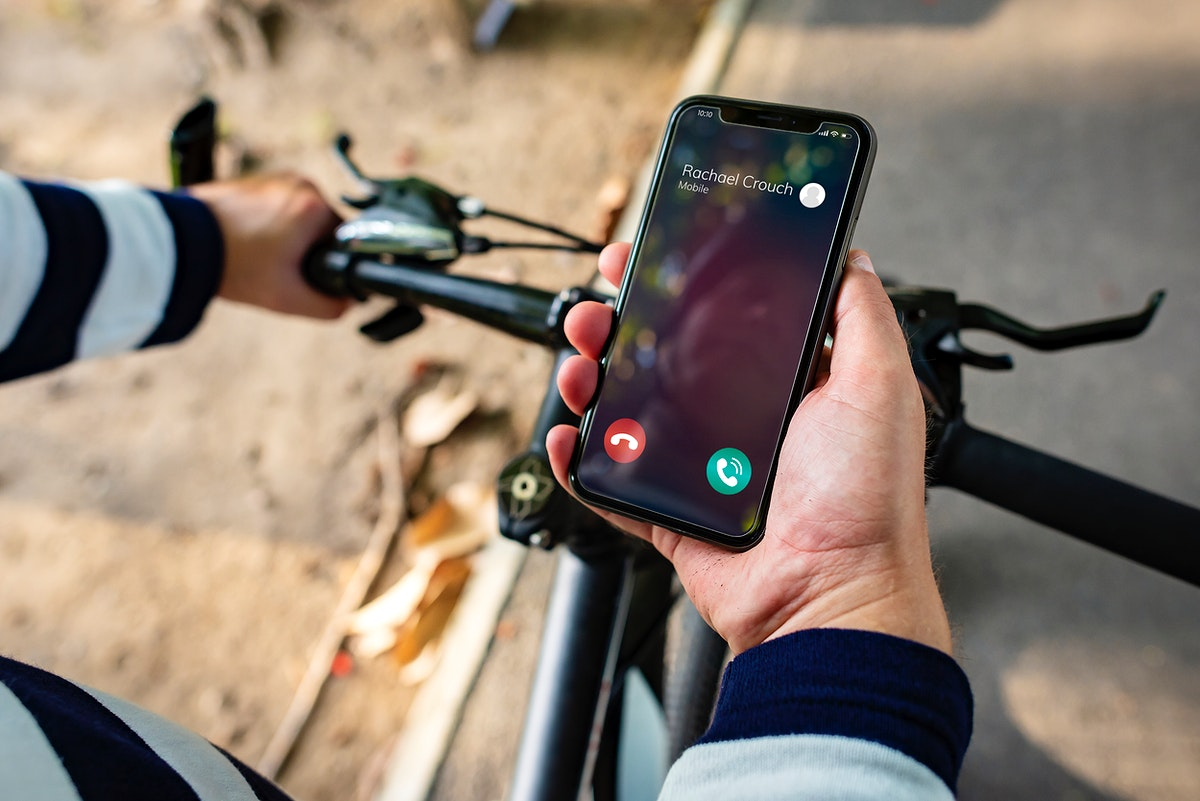 Biker holding smartphone with Incoming call