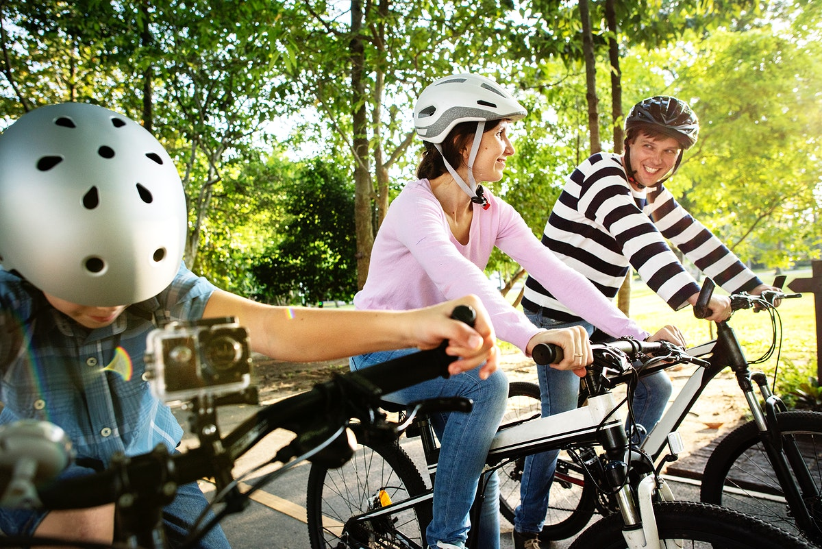 Family on a bike ride in the park