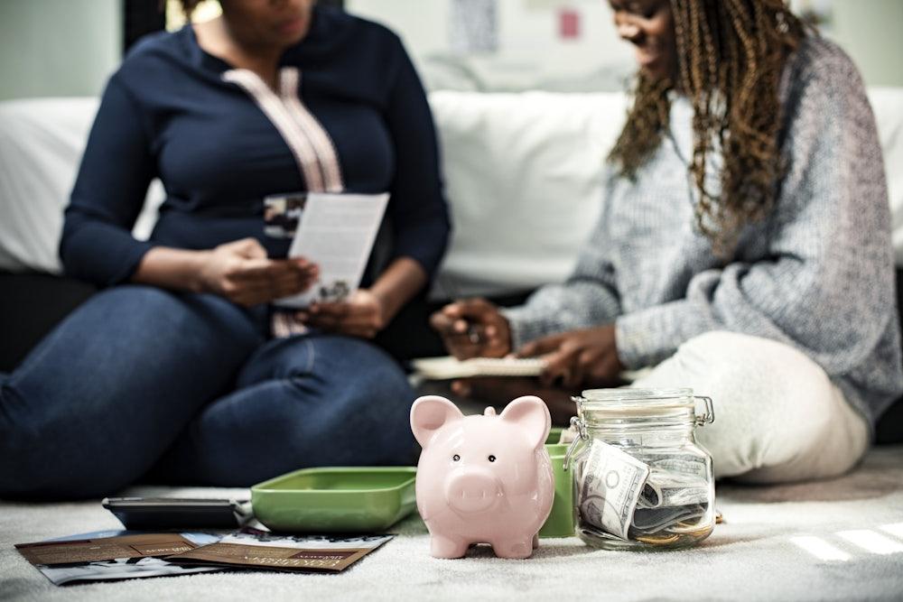 Mother teacher her daughter about savings