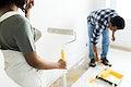 Man painting the walls yellow