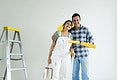 Couple renovating their new house by painting the walls
