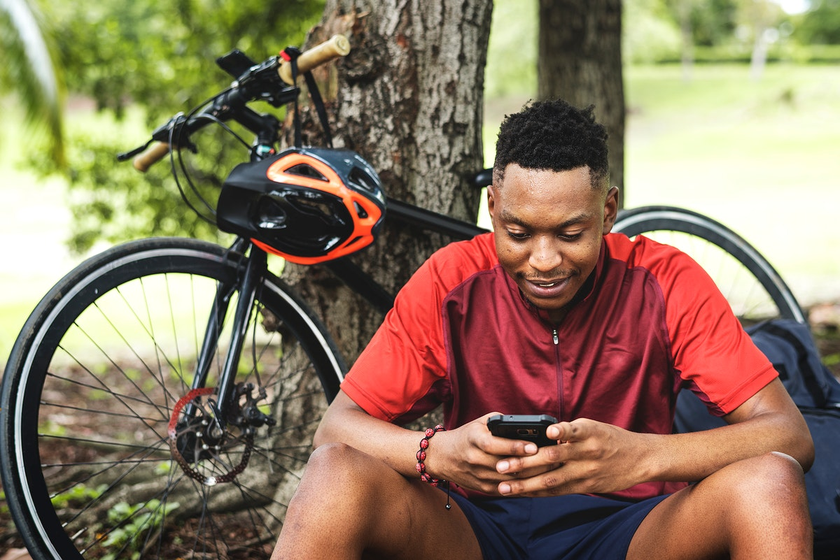 Cyclist on his phone taking a break