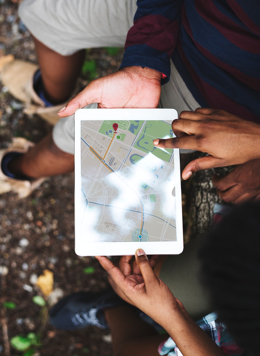 Checking the map on a tablet