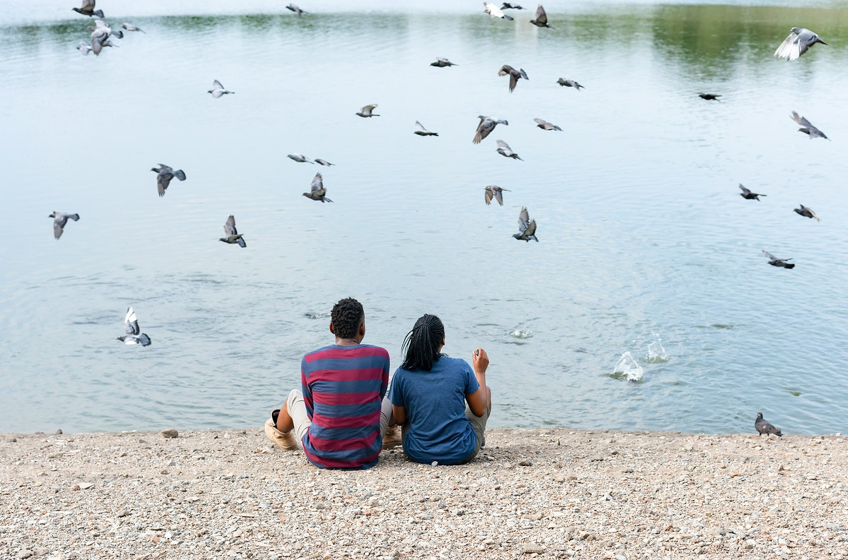 Couple sitting by the lake