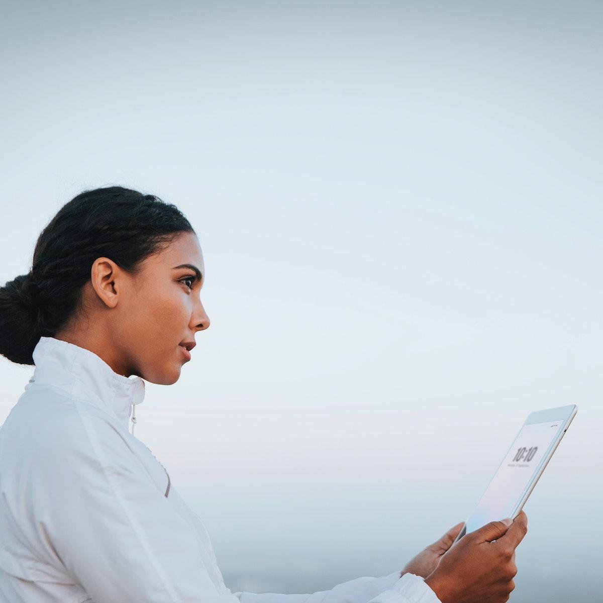 Woman looking at her digital tablet