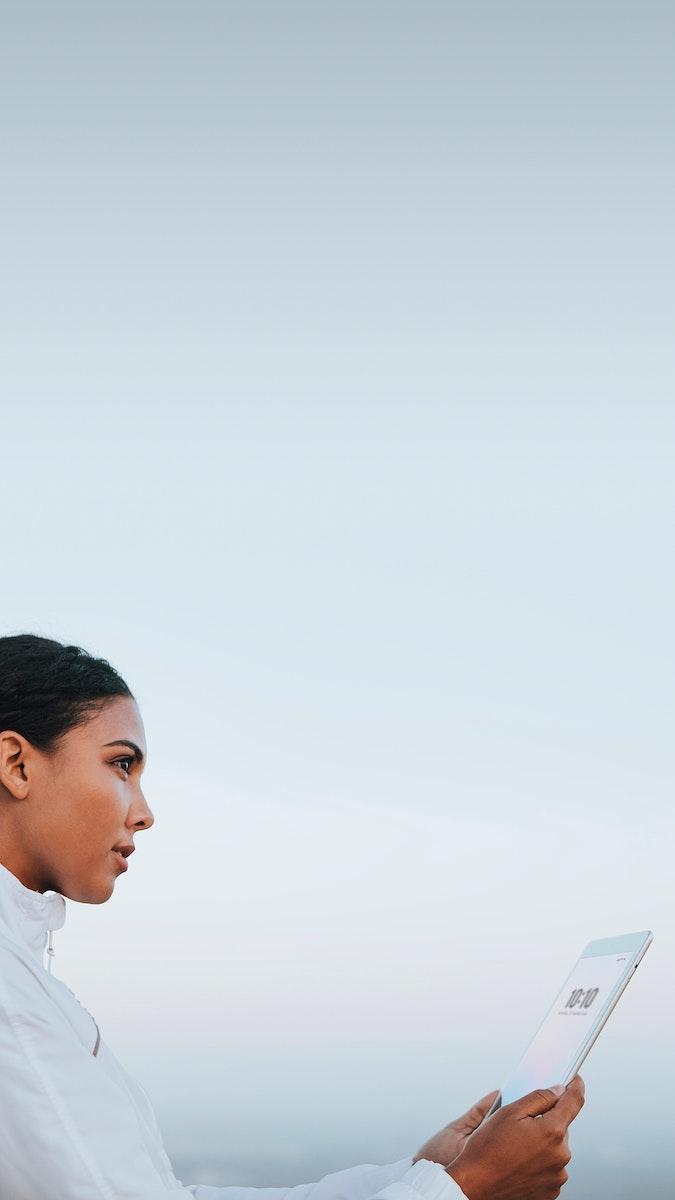 Woman looking at her digital tablet mobile phone wallpaper