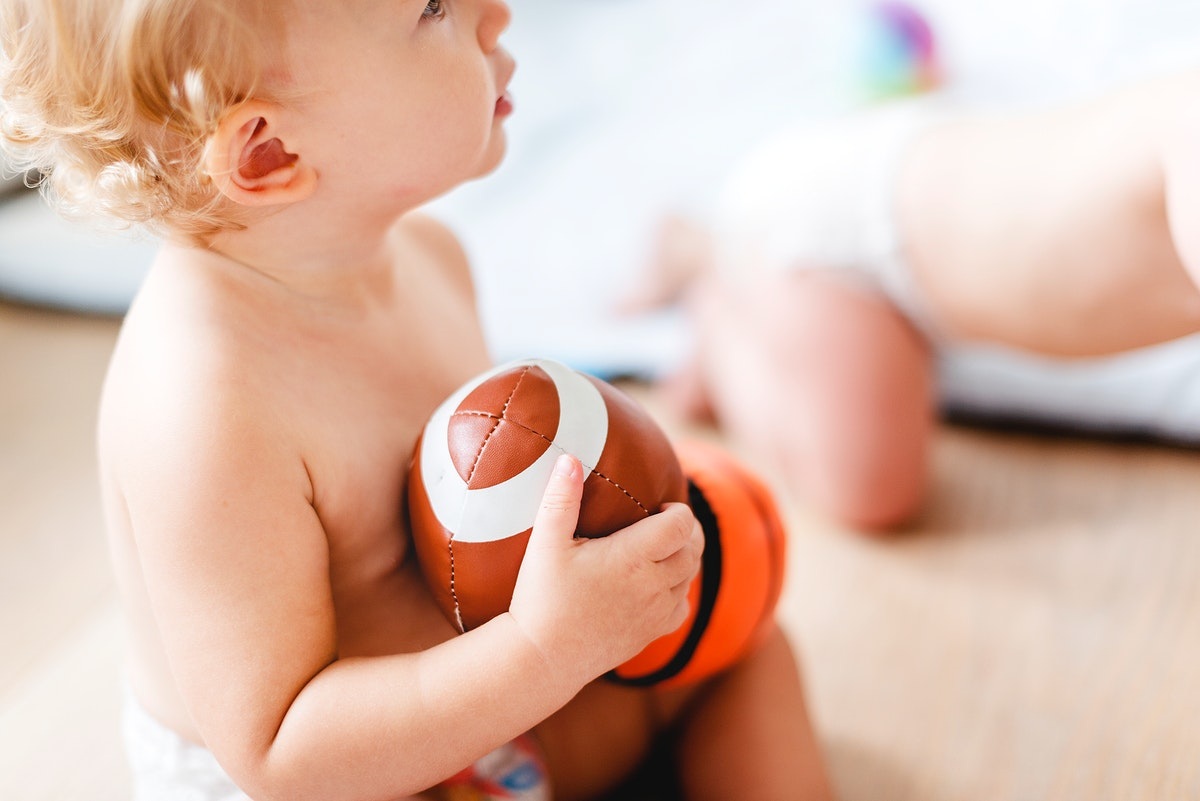 Baby playing with sports balls