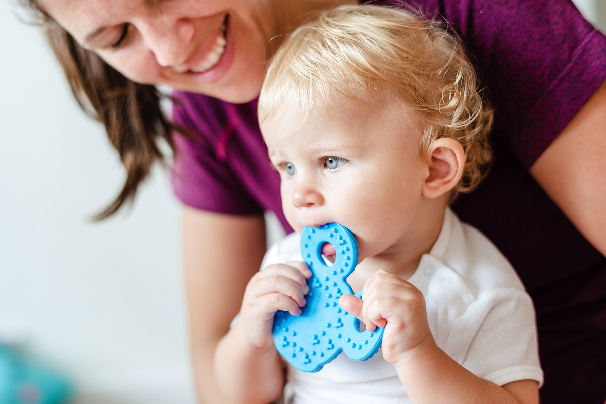 Cute baby chewing on a toy