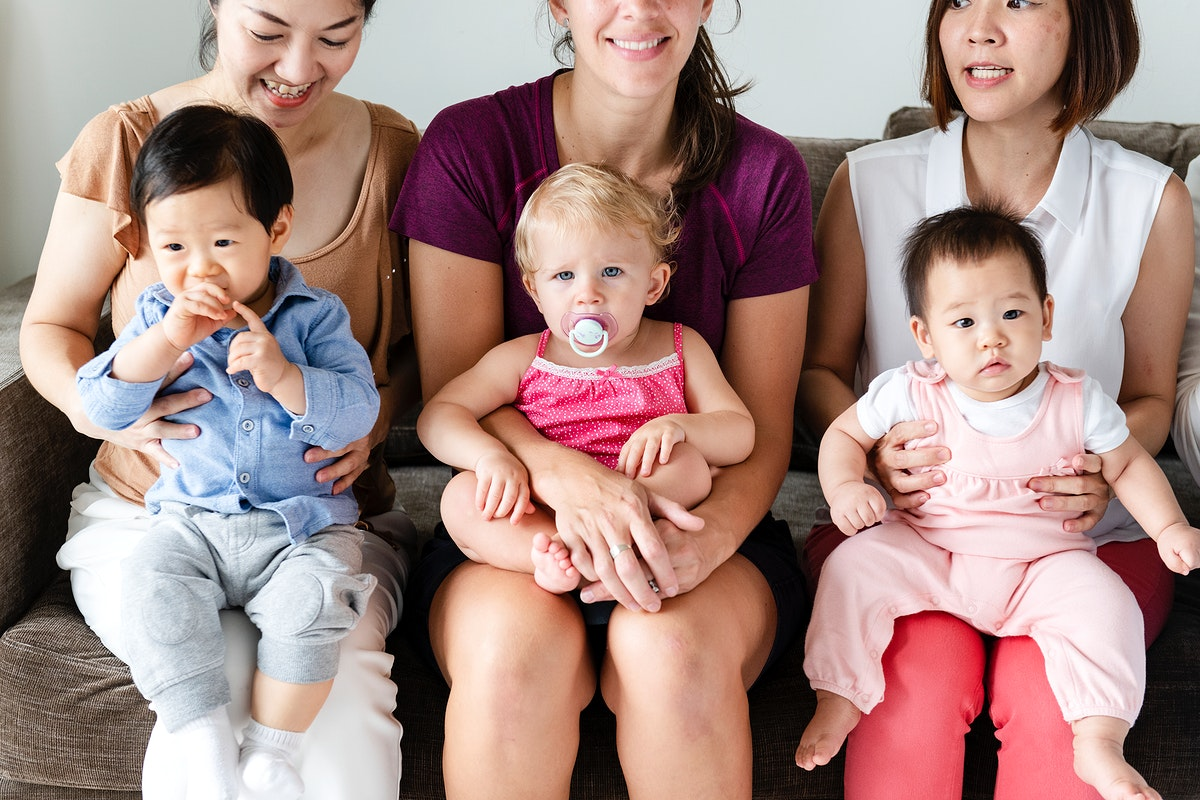 Diverse babies with their parents