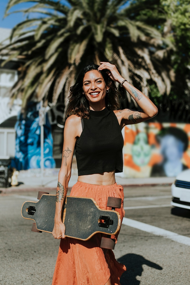 Cool woman with a longboard