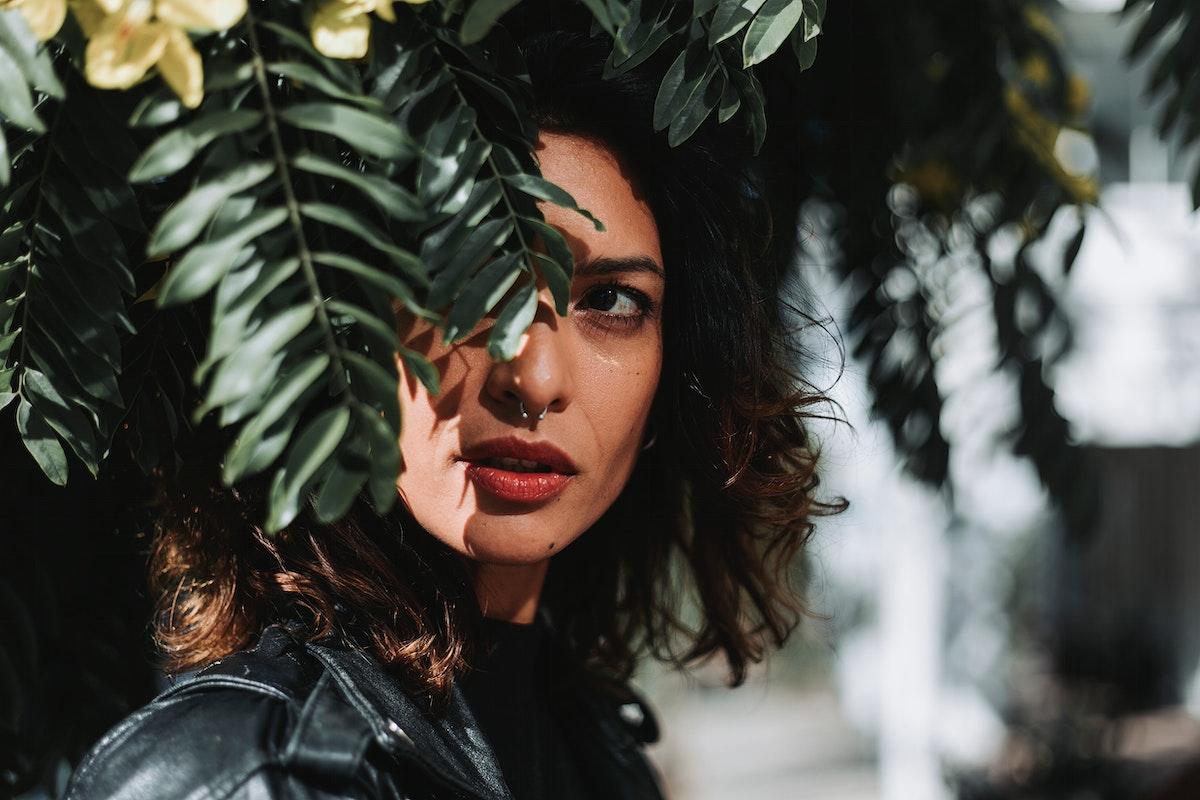 Beautiful woman under a tree