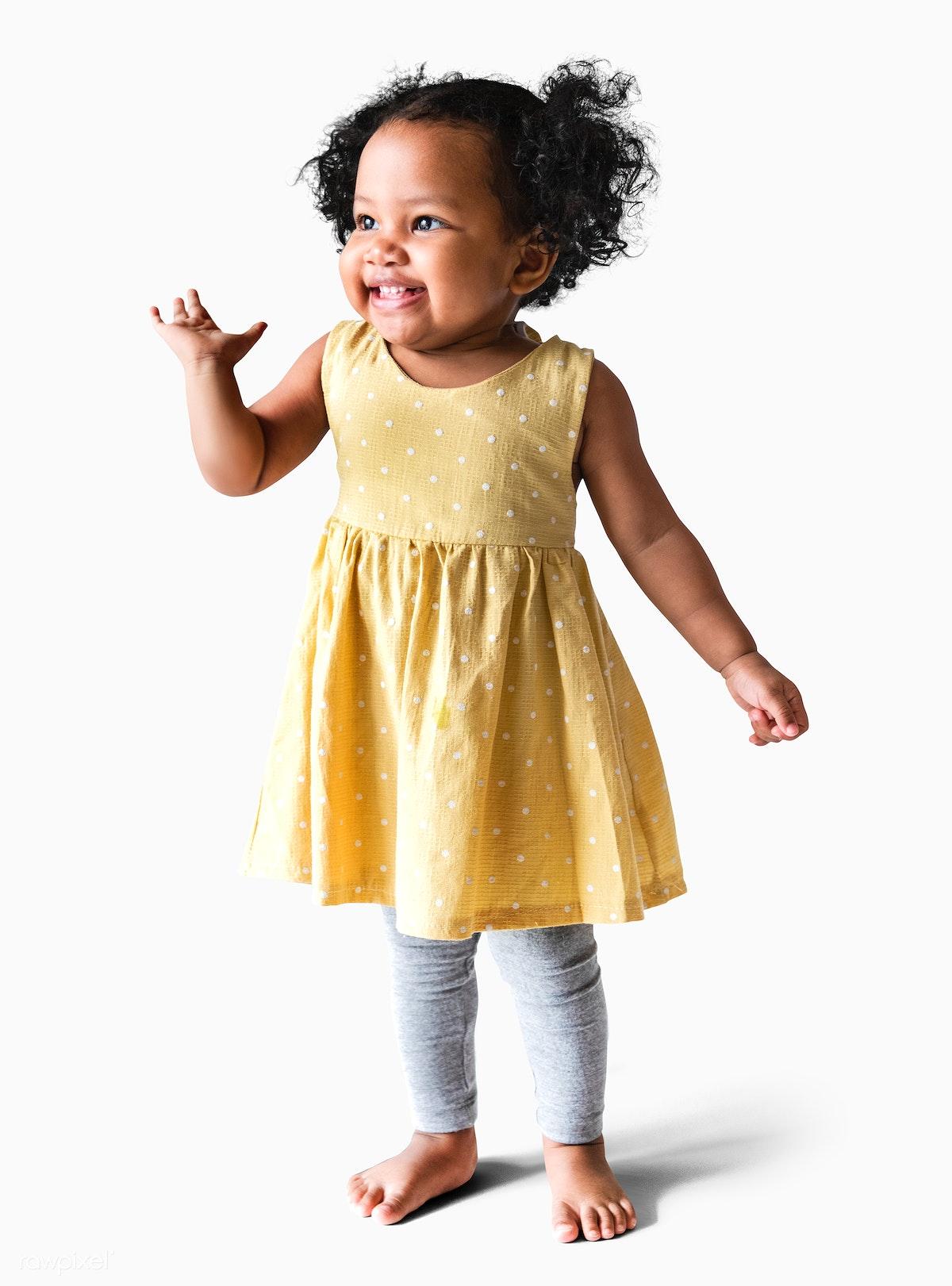 2a68e97eaa925 Happy little girl in a yellow dress