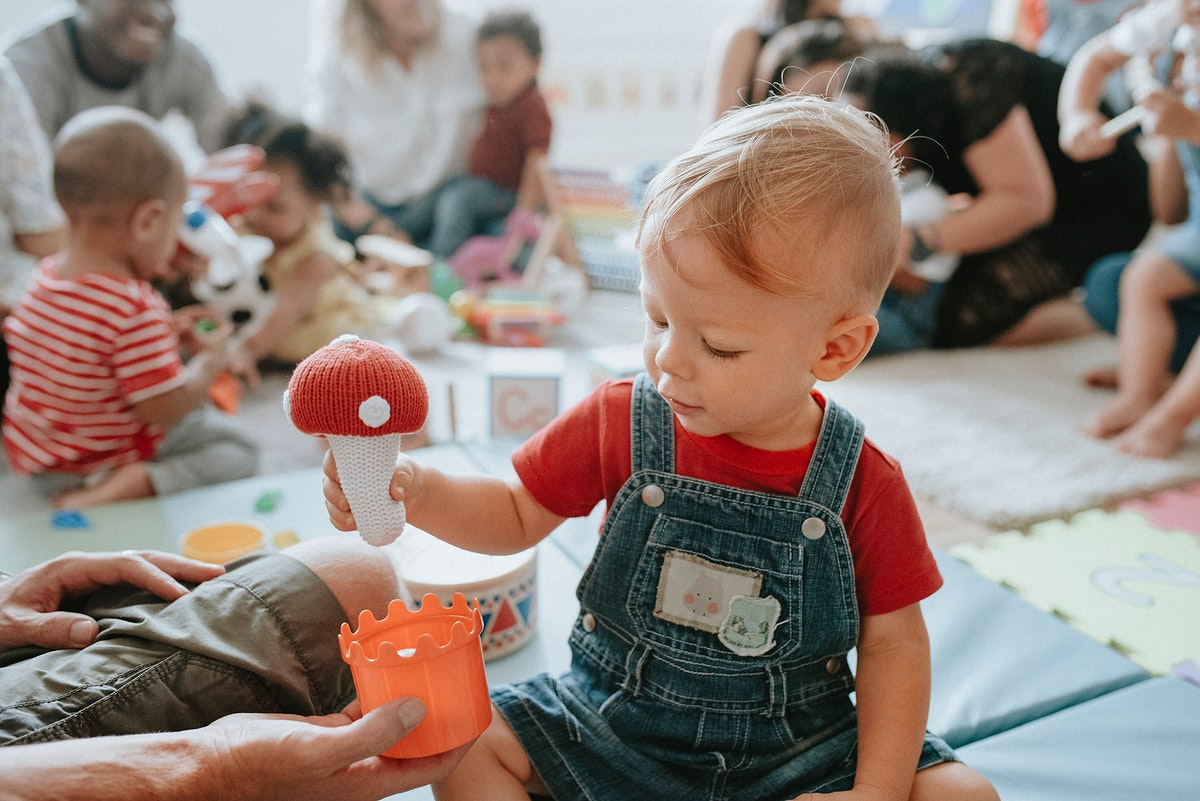 Cute little boy playing with toys at the learning center