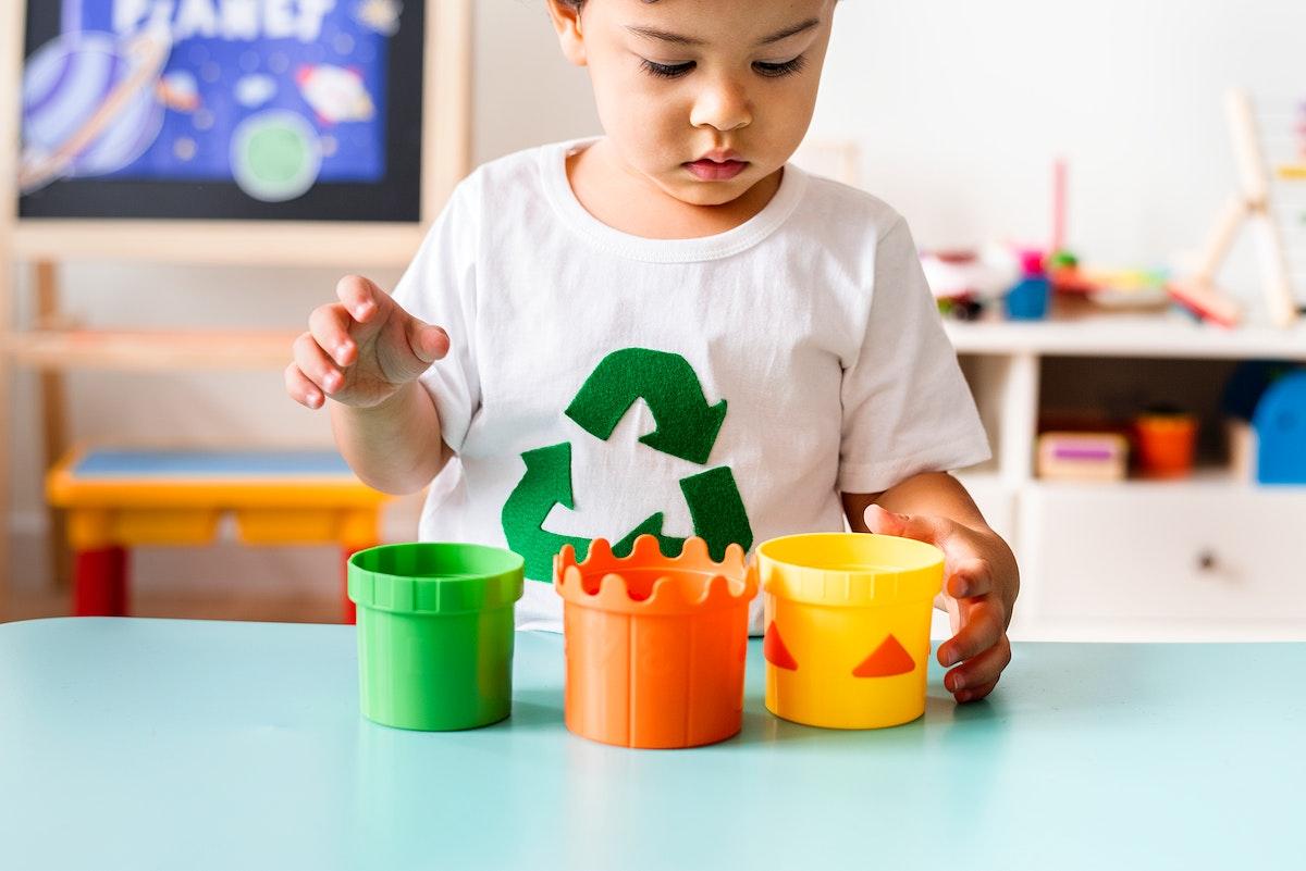 Environmental boy playing toys in a playroom