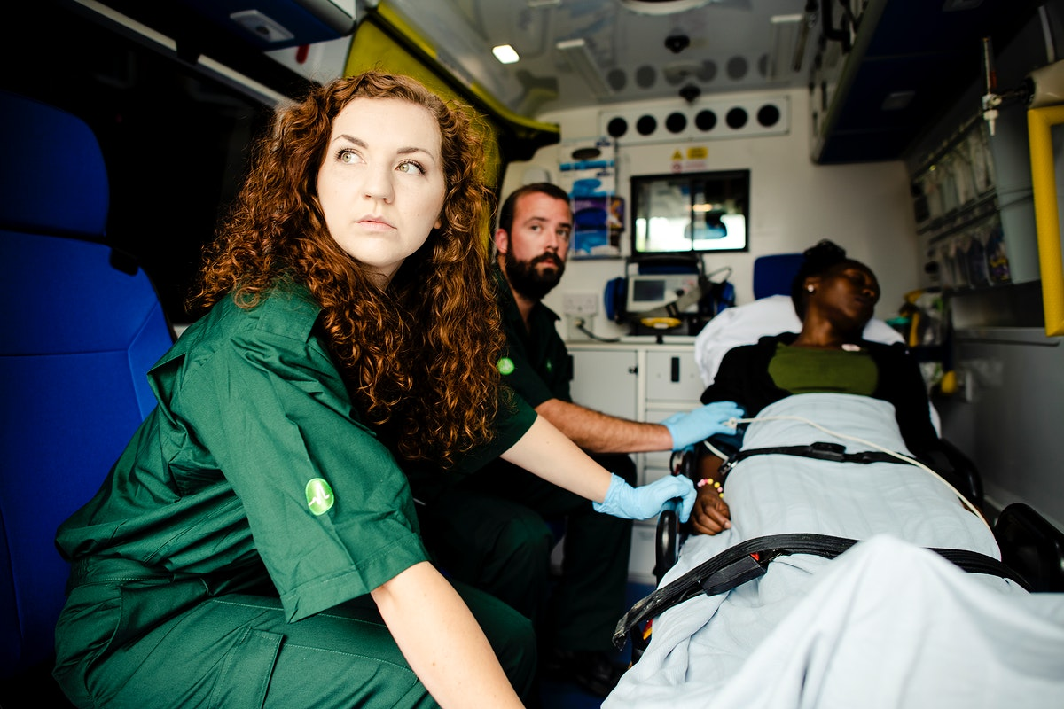 Paramedics with a patient in an ambulance