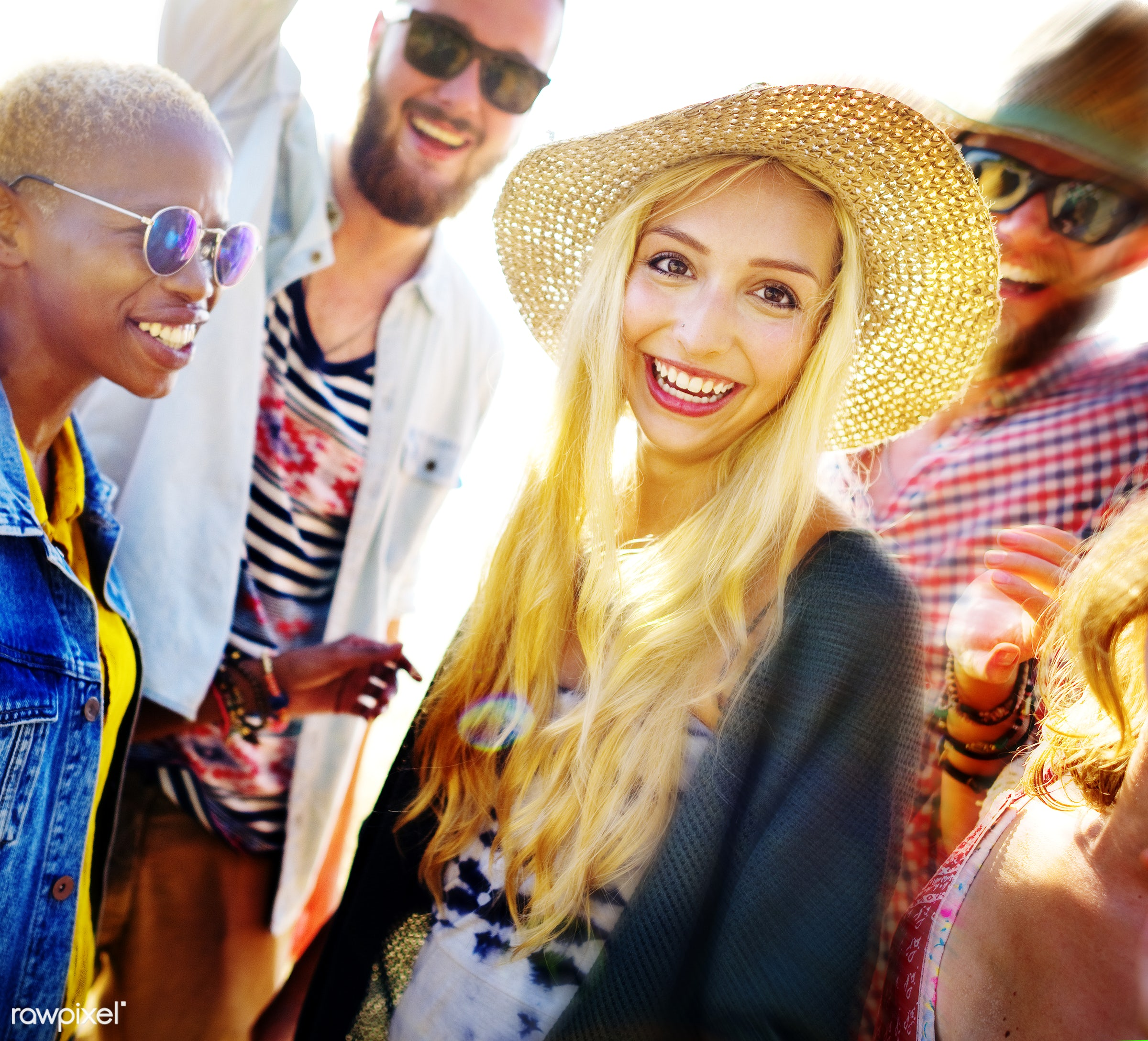 Friends having fun at the beach - friends, friendship, group, people, students, young, diverse, diversity, blonde, black,...