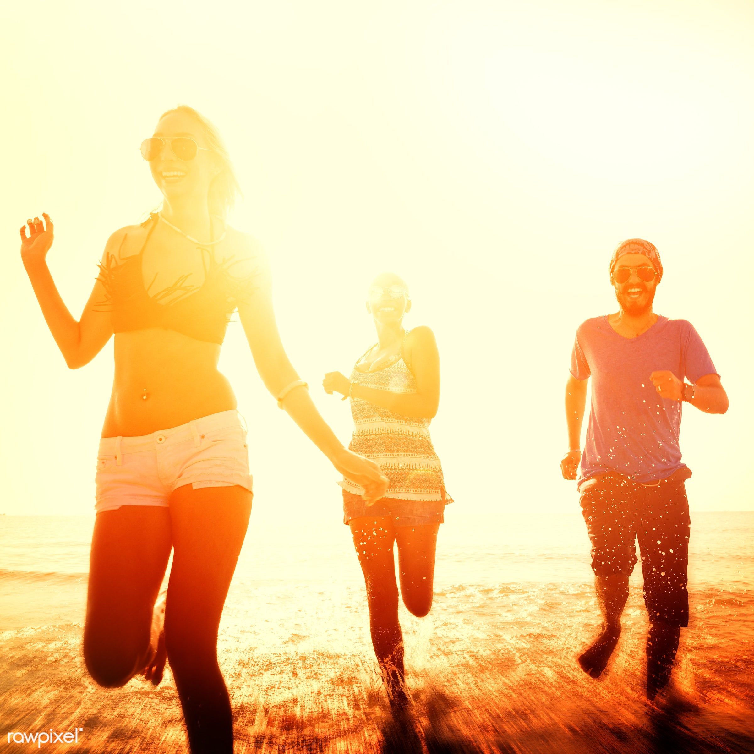 Friends having fun at the beach - action, african descent, asian ethnicity, backlit, beach, bonding, cheerful, chilling, day...
