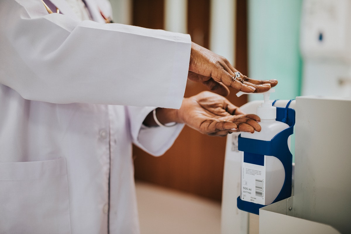 Female physician disinfecting her hands
