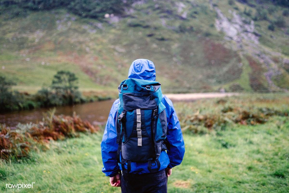 Download premium image of Solo hiker walking in Glen Etive, Scotland 529163