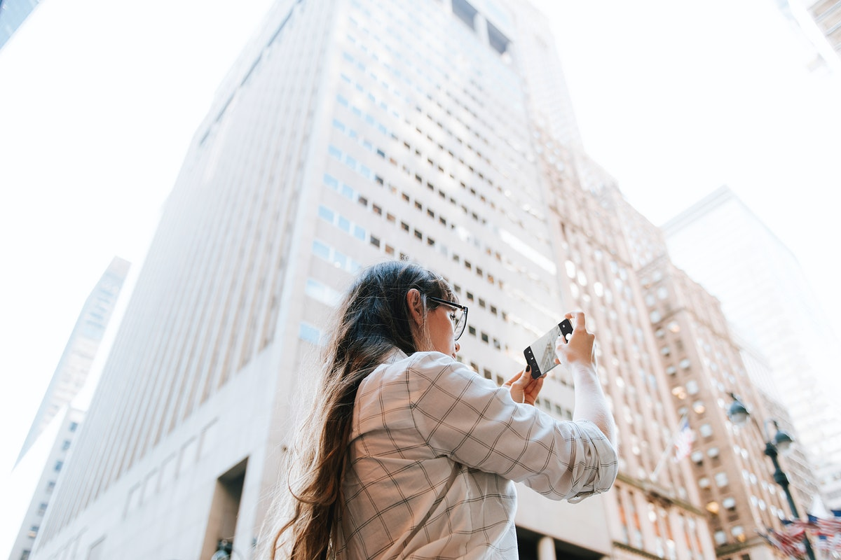 Woman taking a photo of the view in New York City, USA