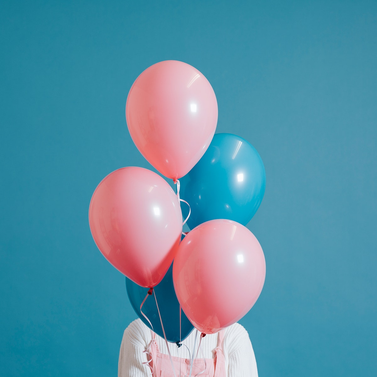Woman with pink and blue balloons