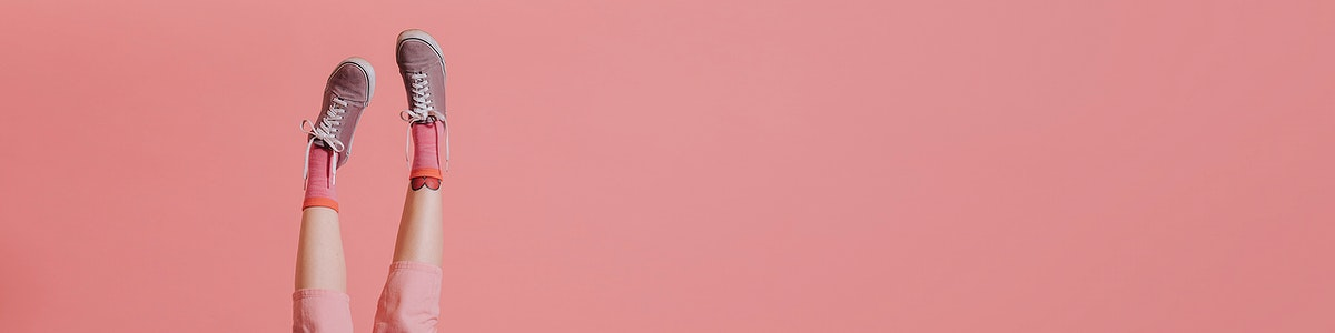 Woman legs in pink pants up in the air social banner