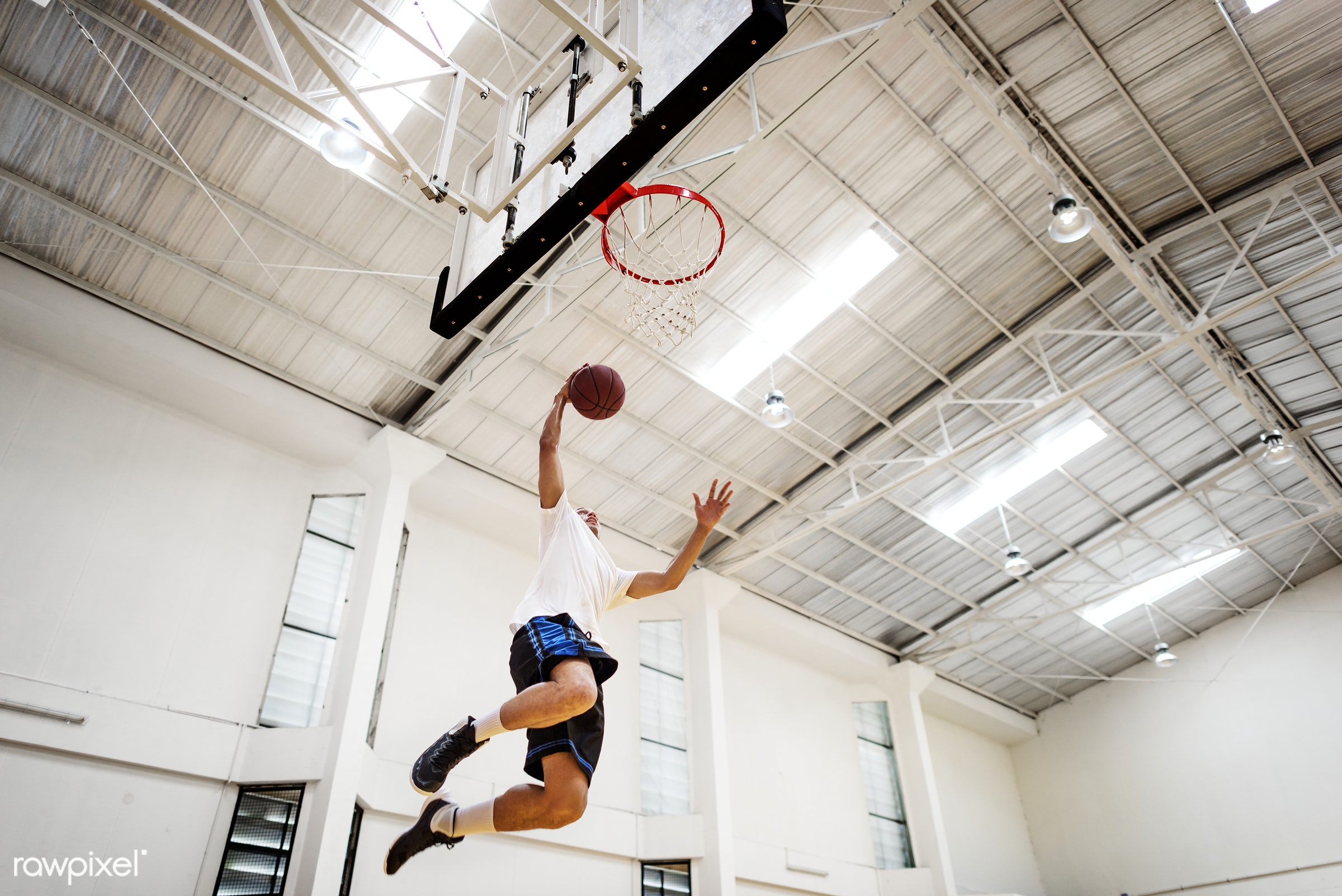 Young basketball player shoot - activity, ball, basketball, boy, dunk, exercise, game, gym, gymnasium, hoop, jump, loop, man...