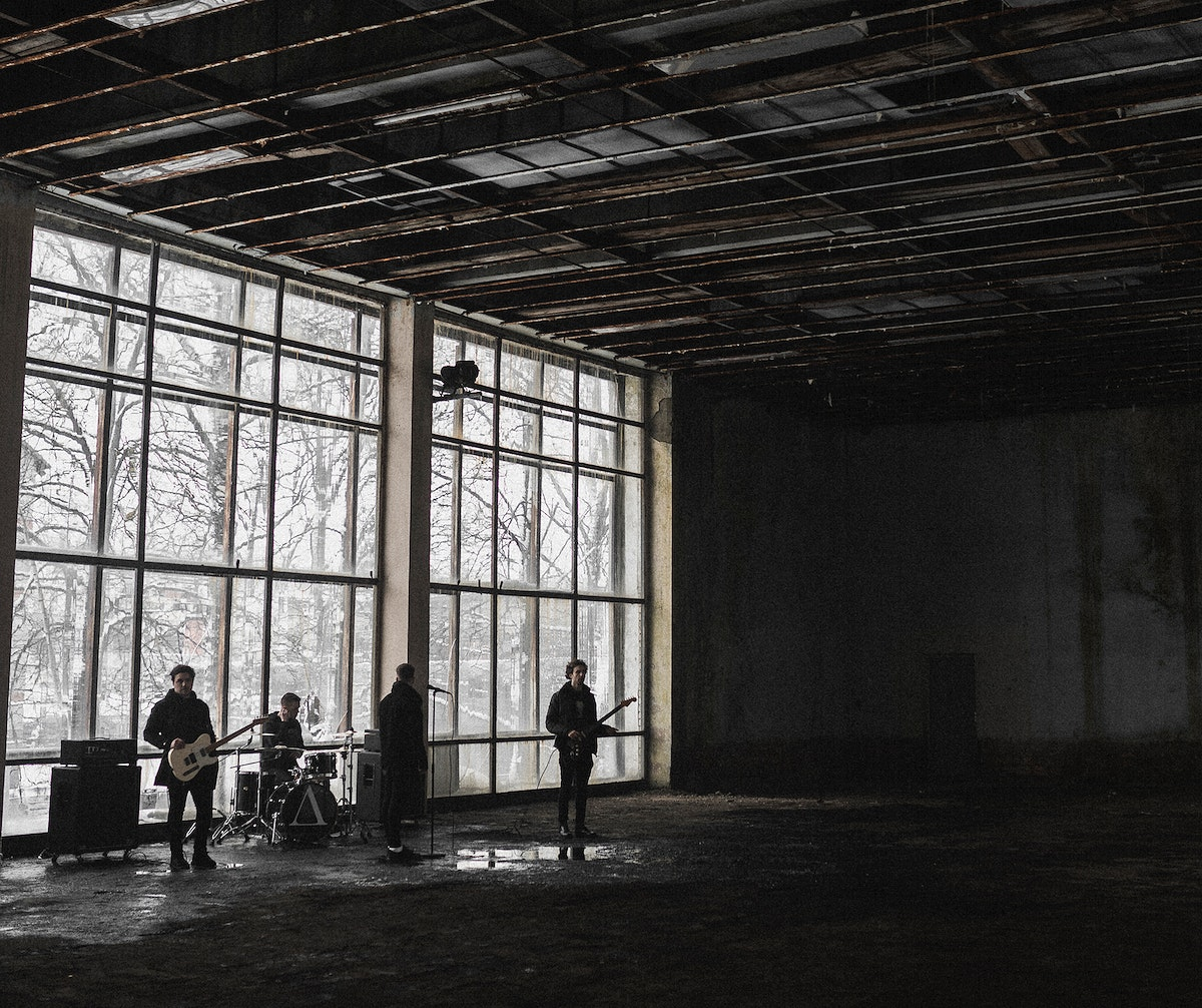 Rock band rehearsing in an abandoned building