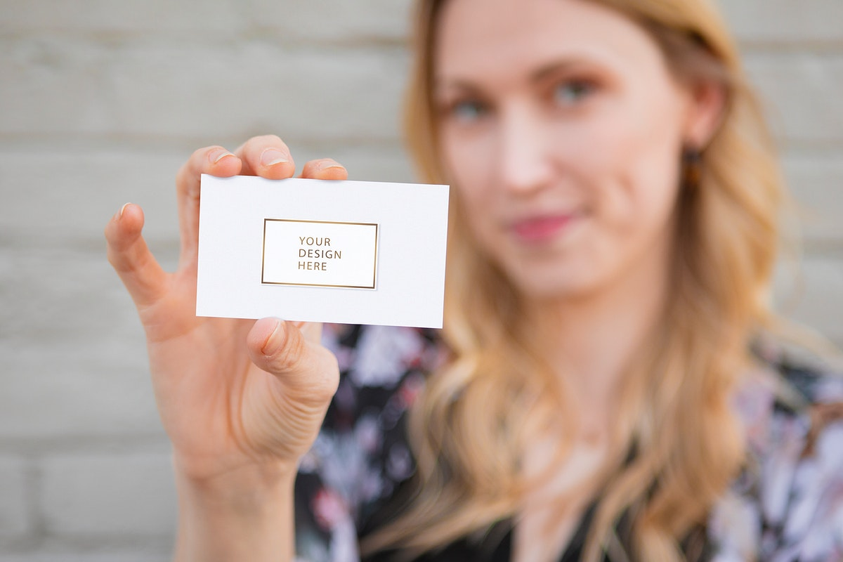Cheerful white woman showing her business card mockup