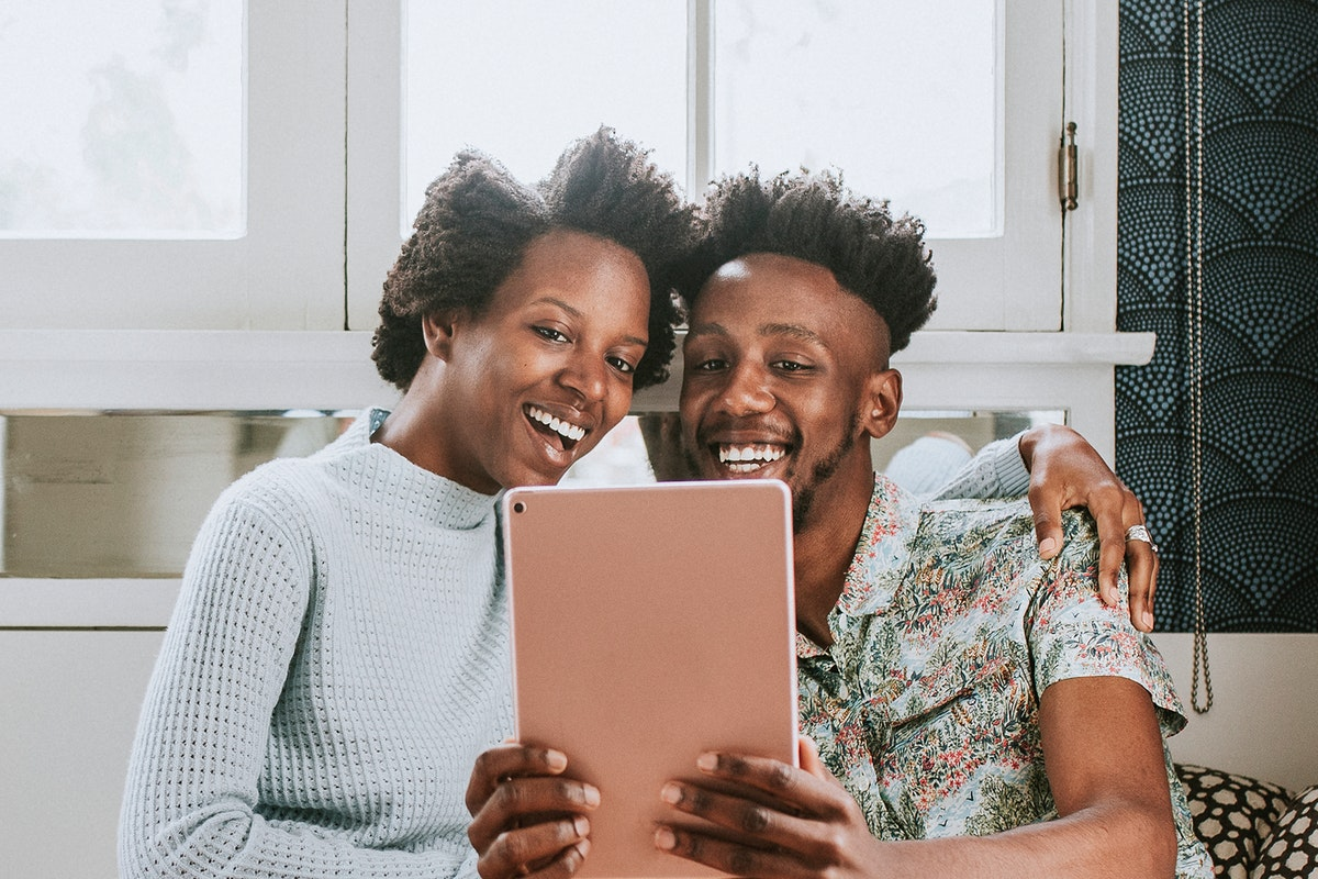 Black couple using a tablet together