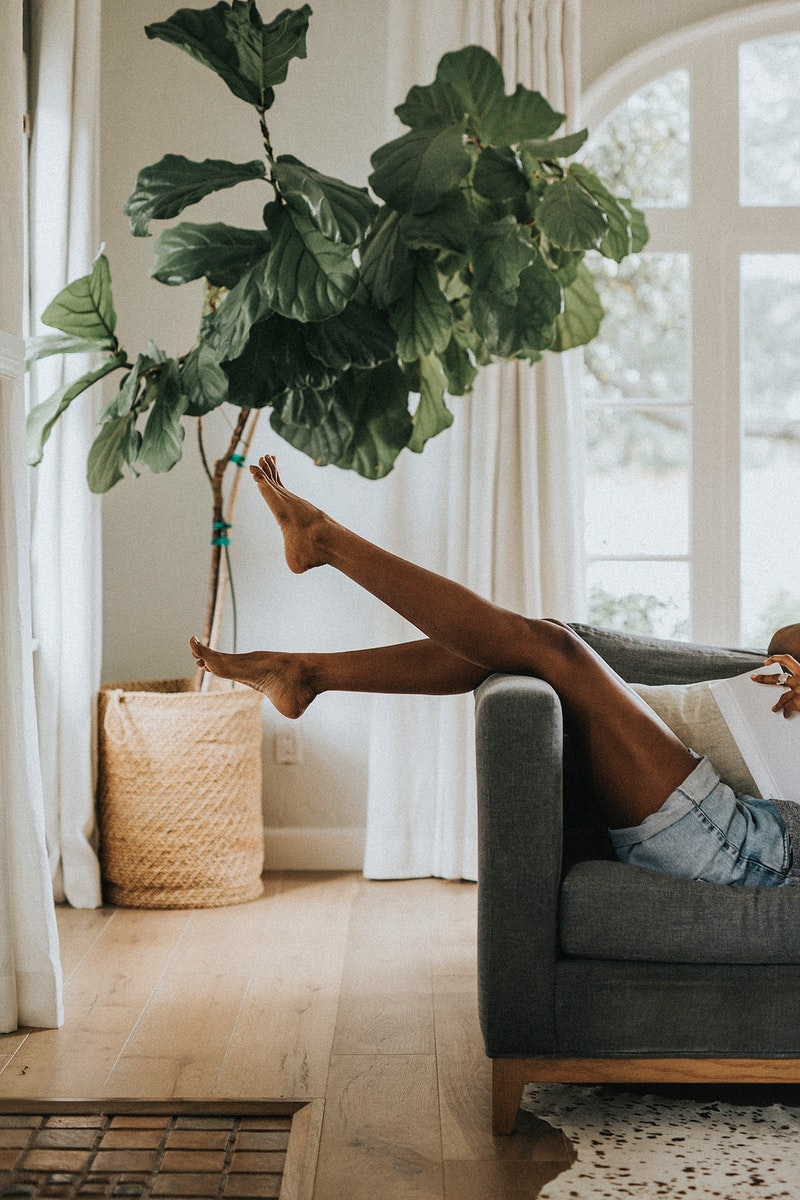 Relaxing on a sofa at home