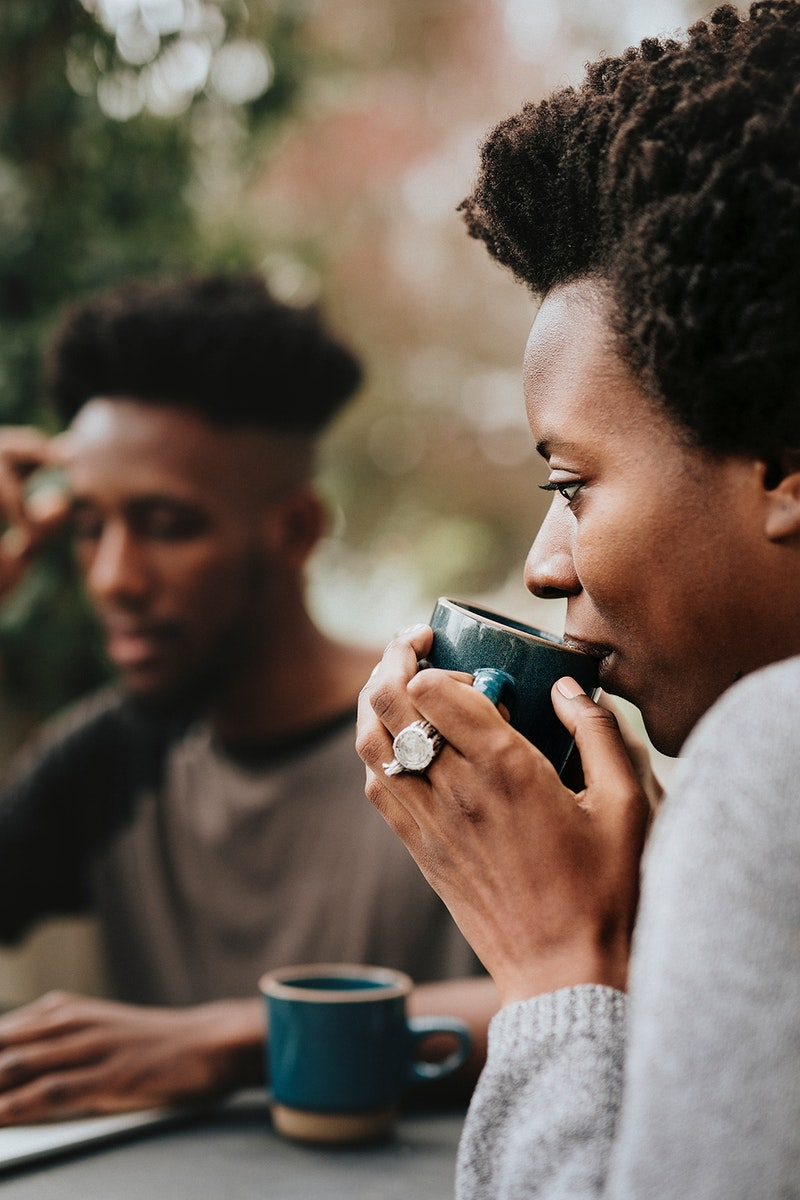 Black couple drinking coffee in the garden