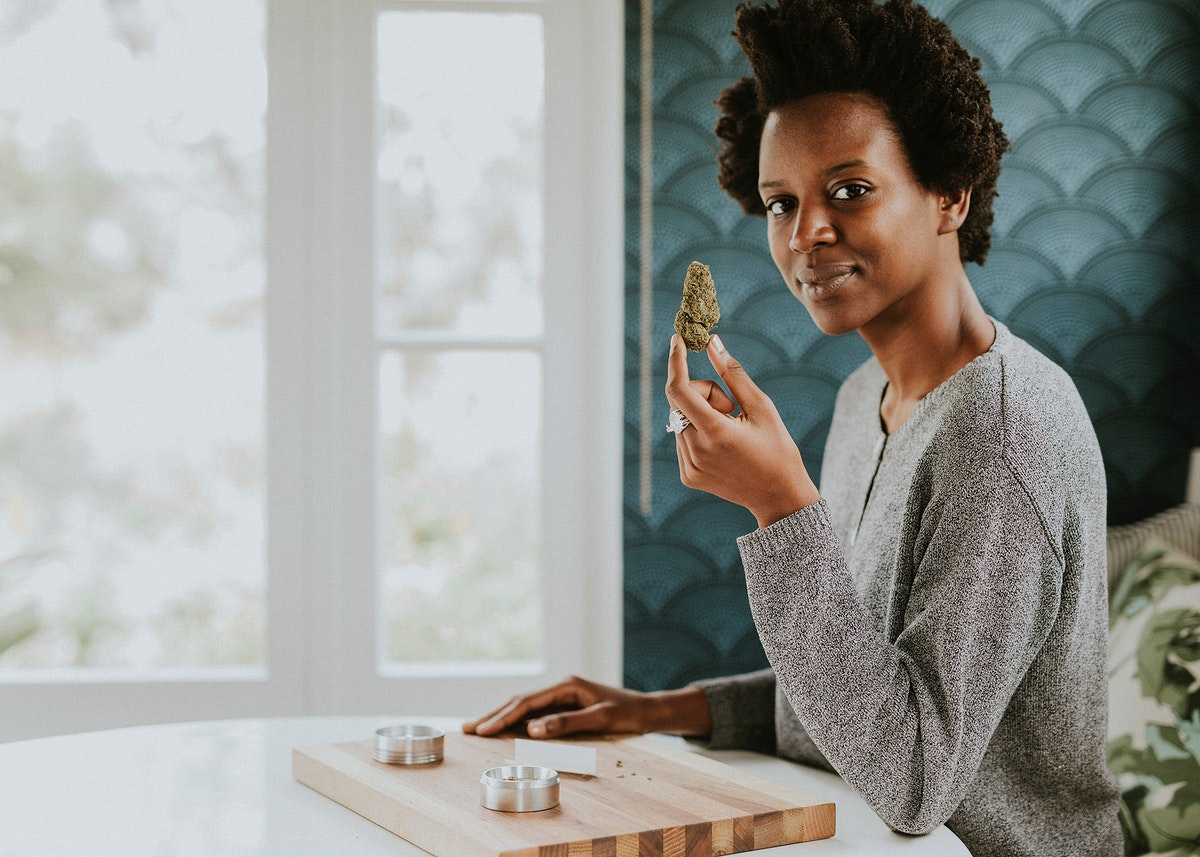 Woman holding weed in hand