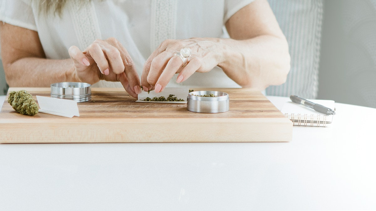 Rolling a weed joint at a chopping block